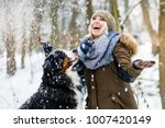 Woman Walking Her Dog In The...