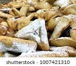 Small photo of Hamantasch pile Purim Jewish holiday traditional food symbol adar