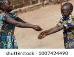 two african children cleaning... | Shutterstock . vector #1007424490
