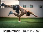 young athletic man balancing... | Shutterstock . vector #1007442259