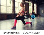 blonde girl working out at a gym | Shutterstock . vector #1007446684