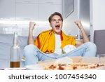 man watching sport on tv at... | Shutterstock . vector #1007454340