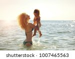 Young Mother In Bikini Standing ...