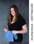 Pretty Smiling Pregnant Woman...