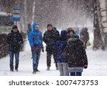 winter street with walking...   Shutterstock . vector #1007473753