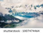 foggy summer view of... | Shutterstock . vector #1007474464