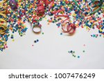 confetti and serpentine on a... | Shutterstock . vector #1007476249