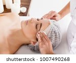 the beautician removes the face ... | Shutterstock . vector #1007490268