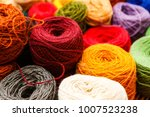 balls of yarn scattered near... | Shutterstock . vector #1007523238