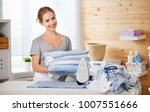 happy woman housewife ironing... | Shutterstock . vector #1007551666