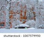 winter snowfall   black car... | Shutterstock . vector #1007579950