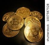 heap of golden bitcoins  the... | Shutterstock . vector #1007587528