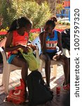 Small photo of Santa Pola, Spain- January 21, 2018: Exhausted Kenyan runners of the Half Marathon of the fishing village of Santa Pola, province of Alicante, on a sunny day in January
