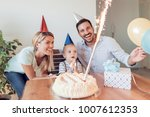birthday.little boy blows out... | Shutterstock . vector #1007612353