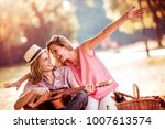 young couple having a picnic in ... | Shutterstock . vector #1007613574