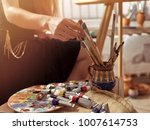 artist painting on easel in... | Shutterstock . vector #1007614753