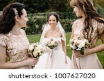 laughing bride and bridesmaids... | Shutterstock . vector #1007627020