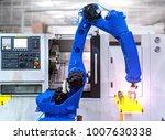 close up robot hands in milling ... | Shutterstock . vector #1007630338