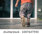 close up of child legs walking... | Shutterstock . vector #1007637550