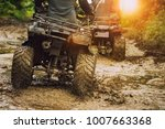 man riding atv vehicle on off... | Shutterstock . vector #1007663368