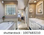 chic ensuite bathroom with his... | Shutterstock . vector #1007683210