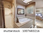 chic ensuite bathroom with... | Shutterstock . vector #1007683216