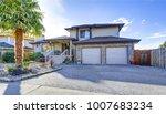 beautiful curb appeal of beige... | Shutterstock . vector #1007683234