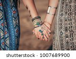 close up hands with boho... | Shutterstock . vector #1007689900