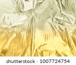shiny golden wrinkled abstract... | Shutterstock . vector #1007724754