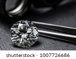 diamond with loupe and tweezers | Shutterstock . vector #1007726686