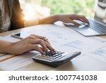 close up business woman using... | Shutterstock . vector #1007741038