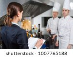 restaurant manager briefing to... | Shutterstock . vector #1007765188