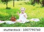 little girl sitting in the grass | Shutterstock . vector #1007790760