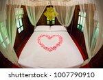 heart shape from pink rose... | Shutterstock . vector #1007790910