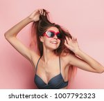 the face of a beautiful young... | Shutterstock . vector #1007792323