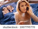 calling the doctor. serious... | Shutterstock . vector #1007795770