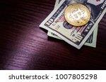 gold coin bitcoin next to the...   Shutterstock . vector #1007805298