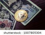 gold coin bitcoin next to the...   Shutterstock . vector #1007805304