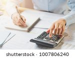 accountant working on desk in... | Shutterstock . vector #1007806240