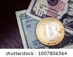 gold coin bitcoin next to the...   Shutterstock . vector #1007806564