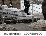 winter. uncleaned stairs.... | Shutterstock . vector #1007809900