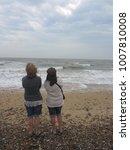 A Seascape Of Two Women In...