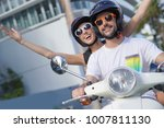 cheerful couple riding scooter... | Shutterstock . vector #1007811130