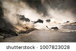 wildebeest crossing the mara... | Shutterstock . vector #1007823028
