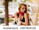 lightly tanned blonde girl... | Shutterstock . vector #1007854120