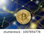 macro shot of golden bitcoin ...   Shutterstock . vector #1007856778