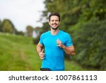 happy man running in park...   Shutterstock . vector #1007861113