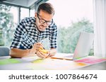 designer working from home... | Shutterstock . vector #1007864674