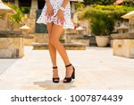 woman with slim sexy legs... | Shutterstock . vector #1007874439