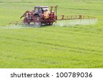 A Red Old Tractor Fertilizes A...